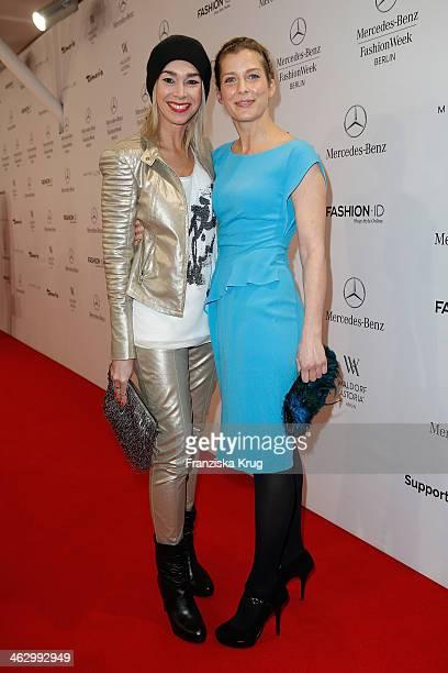 Valerie Niehaus and Kiki Viebrock attend the Laurel show during Mercedes-Benz Fashion Week Autumn/Winter 2014/15 at Brandenburg Gate on January 16,...