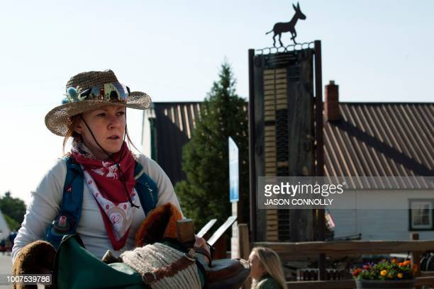 Valerie Nussbaumer of Hood River Oregon waits in line to register for the Pack Burro Race during the 70th Annual Burro Days in Fairplay Colorado on...