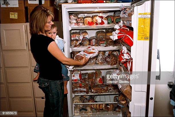 Valerie one of three wives in a polygamist family from the Salt Lake Valley takes some bread in the fridge reserve only for the bread of the familly...