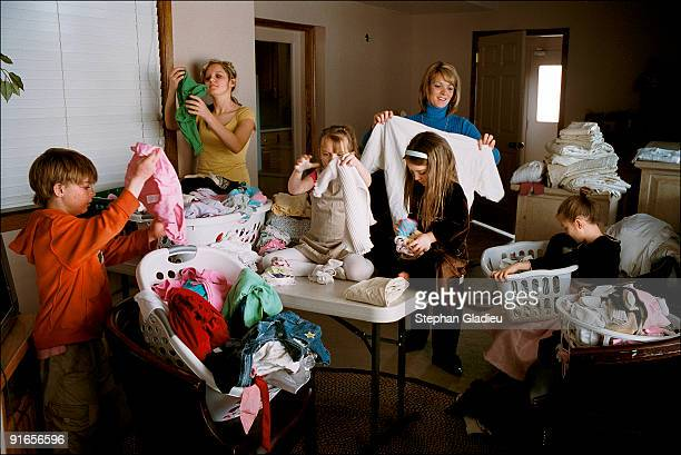 Valerie, one of three wives in a polygamist family living in the Salt Lake Valley, folds the laundry with the help of five children. This plural...