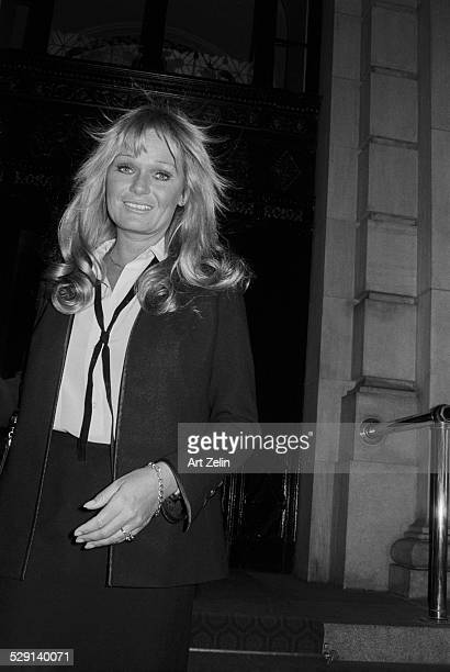Valerie Perrine leaving a building circa 1970 New York