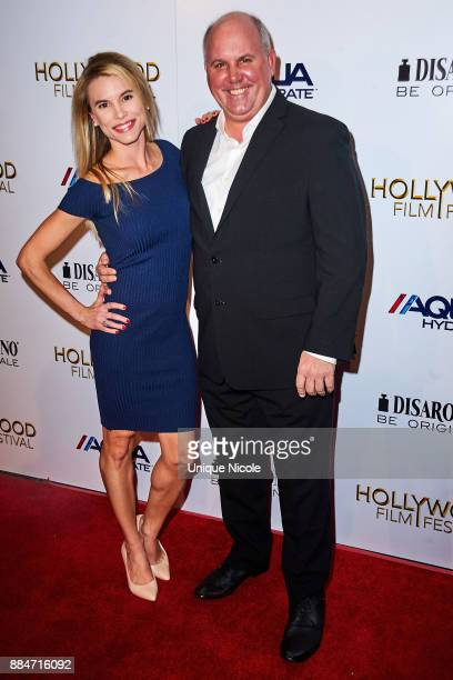 Valerie Renee Heckel and James Dumont attend Hollywood Film Festival Honors Film And TV Icon Ed Asner at Paramount Theatre on December 2 2017 in...