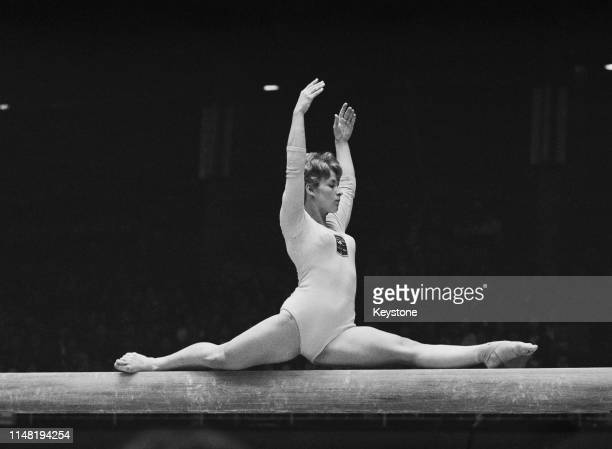 Valerie Roberts of Australia performs on the beam during the Women's balance beam gymnastic competition on 21st October 1964 during the XVIII Summer...