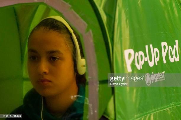 Valerie Sanchez records vocals in a pop-up tent during choir class at Wenatchee High School on February 26, 2021 in Wenatchee, Washington. The school...