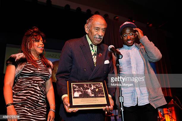 Valerie Simpson John Conyers and John Conyers Jr attend the 2014 Congressional Black Caucus Jazz Concert at Walter E Washington Convention Center on...