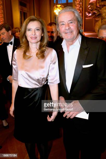 Valerie Trierweiler and Alain Delon attend Tricentenary of the French dance school AROP Gala at Opera Garnier on April 15 2013 in Paris France