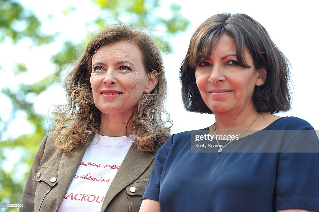 Valerie Trierweiler and Anne Hidalgo pose during the 'Bring Back Our Girls' Ephemeral Exhibition, bringing awareness to the 220 young women kidnapped in Nigeria now more than 100 days ago, on July 28, 2014 in Paris, France. The ELLE Foundation is working to support women's rights and 'Bring Back Our Girls' - Ephemeral Exhibition by displaying 220 silhouettes at Place de la Republique.
