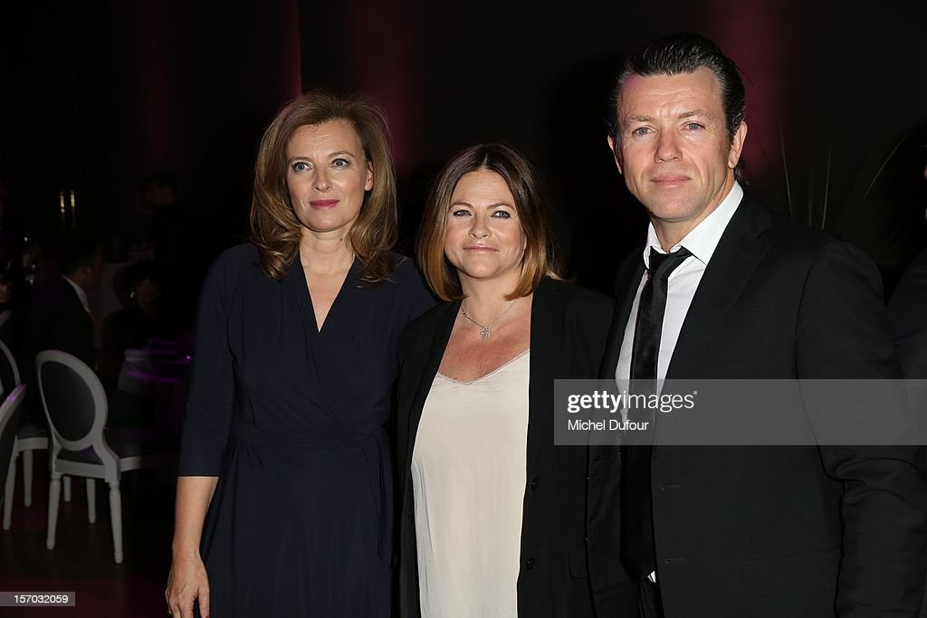 Valerie Trierweiler, Charlotte Valandrey and guest attend the AIDES International Gala Dinner at Grand Palais on November 27, 2012 in Paris, France.