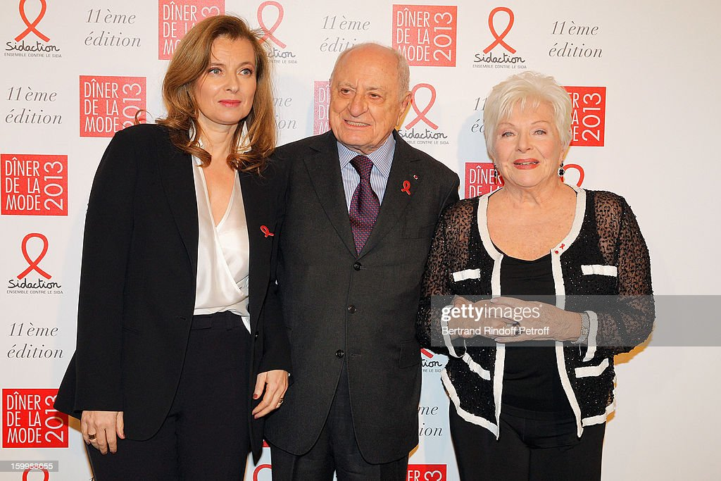 Valerie Trierweiler, Pierre Berge and Line Renaud pose as they arrive to attend the Sidaction Gala Dinner 2013 at Pavillon d'Armenonville on January 24, 2013 in Paris, France.