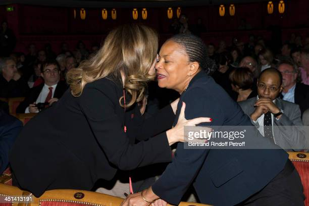 Valerie Trierweiler the companion of French President Francois Hollande kisses French Justice Minister Christiane Taubira during the award giving...