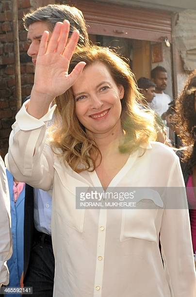 Valerie Trierweiler the expartner of French President Francois Hollande waves during a visit to the Ekta Nagar slums in the Mandala area of Mumbai on...