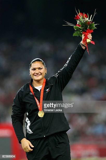 Valerie Vili of New Zealand receives the gold medal during the medal ceremony for the Women's Shot Put Final held at the National Stadium on Day 9 of...