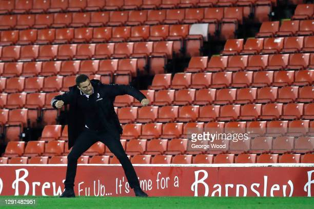 Valerien Ismael, head coach of Barnsley celebrates after their sides second goal scored by Victor Adeboyejo of Barnsley during the Sky Bet...