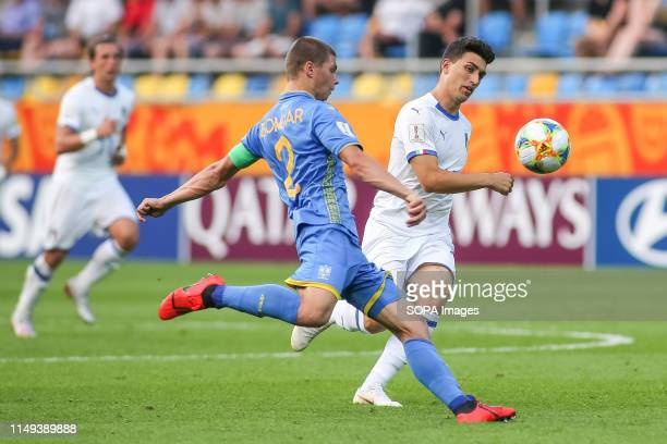 Valerii Bondar of Ukraine and Christian Capone of Italy are seen in action during the FIFA U-20 World Cup match between Ukraine and Italy in Gdynia. .