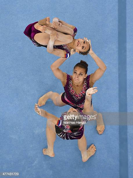 Valeriia Belkina Yulia Nikitina and Zhanna Parkhometc of Russia compete in the Gymnastics Acrobatic Women's Group Dynamic Qualification during day...