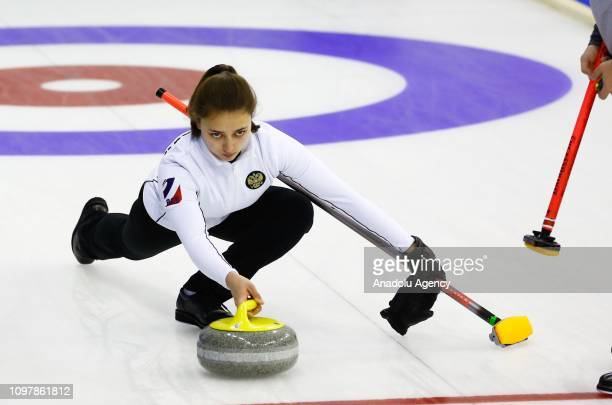 Valeriia Denisenko of Russia curling team pushes the stone during a curling match between Turkey and Russia within the 2019 EYOF in Sarajevo, Bosnia...
