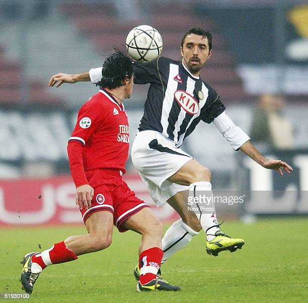 Valerio Bertotto of Udinese battles with Mauro Esposito of Cagliari during the Serie A match between Udinese and Cagliari at the Friuli stadium on...