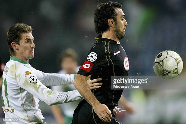 Valerio Bertotto of Udinese challenges for the ball with Miroslav Klose of Werder during the Champions League Group C match between Udinese and...