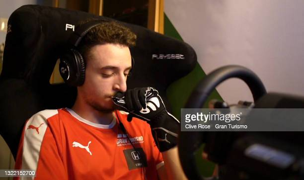 Valerio Gallo of Italy) reacts after spinning out of the race during round 1 of the Manufacturers Series in the Gran Turismo World Series 2021 run at...