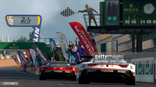 Valerio Gallo of Italy takes the chequered flag ahead of Takuma Miyazono of Japan to win the Nations Cup grand final of the FIA Gran Turismo World...