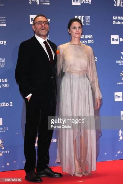 Valerio Mastandrea and Chiara Martegiani walk a red carpet ahead of the 64 David Di Donatello awards ceremony Red Carpet on March 27 2019 in Rome...
