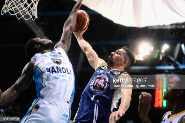 Valerio Mazzola of Fiat competes with Kelvin Martin and Henry Sims of Vanoli during the match semifinal of Coppa Italia between Vanoli Cremona and...