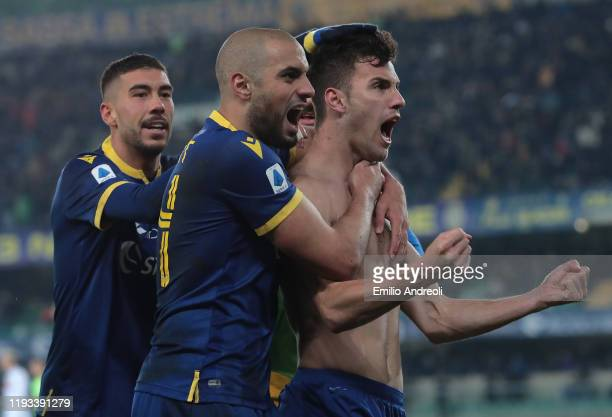 Valerio Verre of Hellas Verona celebrates his goal with his teammates Sofyan Amrabat and Mattia Zaccagni during the Serie A match between Hellas...