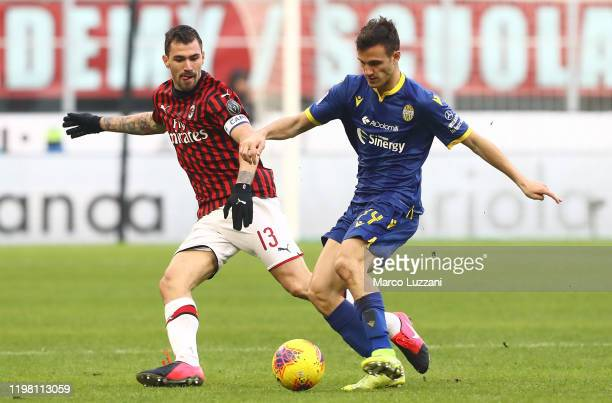 Valerio Verre of Hellas Verona competes for the ball with Alessio Romagnoli of AC Milan during the Serie A match between AC Milan and Hellas Verona...