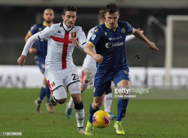 Valerio Verre of Hellas Verona is challenged by Francesco Cassata of Genoa CFC during the Serie A match between Hellas Verona and Genoa CFC at Stadio...