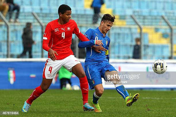 Valerio Verre of Italy competes for the ball with Manuel Akanji of Switzerland during the 4 Nations Tournament match between Italy U20 and...