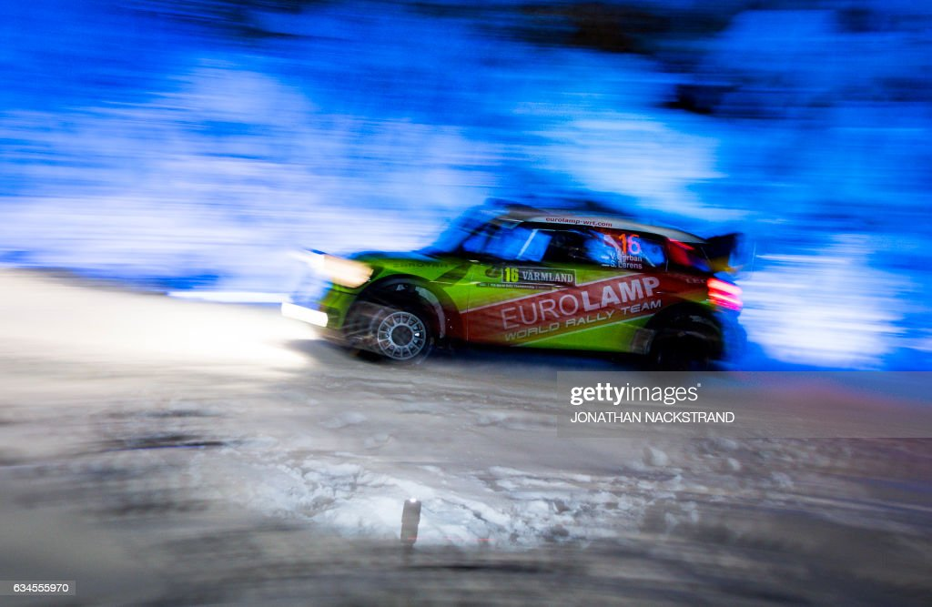 TOPSHOT - Valeriy Gorban of Ukraine and his co-driver Sergei Larens of Estonia compete in their BMW-Mini John Cooper Works during the 8th stage of the Rally Sweden, second round of the FIA World Rally Championship on February 10, 2017 in Torsby, Sweden. / AFP PHOTO / Jonathan NACKSTRAND