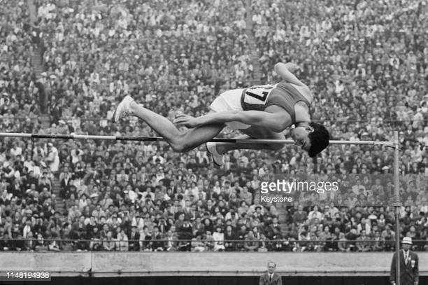 Valeriy Skvortsov of the Soviet Union competes in the Men's High Jump competition on 21st October 1964 during the XVIII Summer Olympic Games at the...