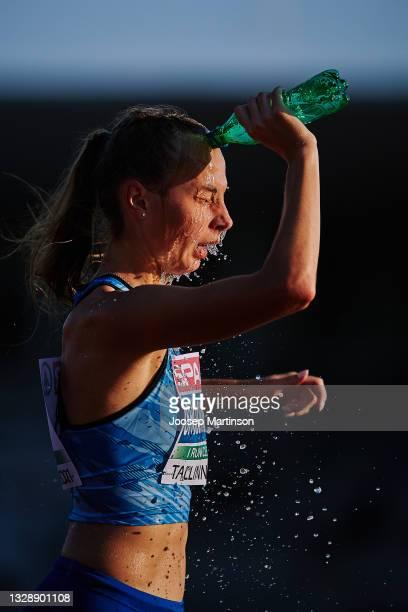 Valeriya Sholomitska of Ukraine cools herself in the Women's 10000m Race Walk during European Athletics U20 Championships Day 1 at Kadriorg Stadium...