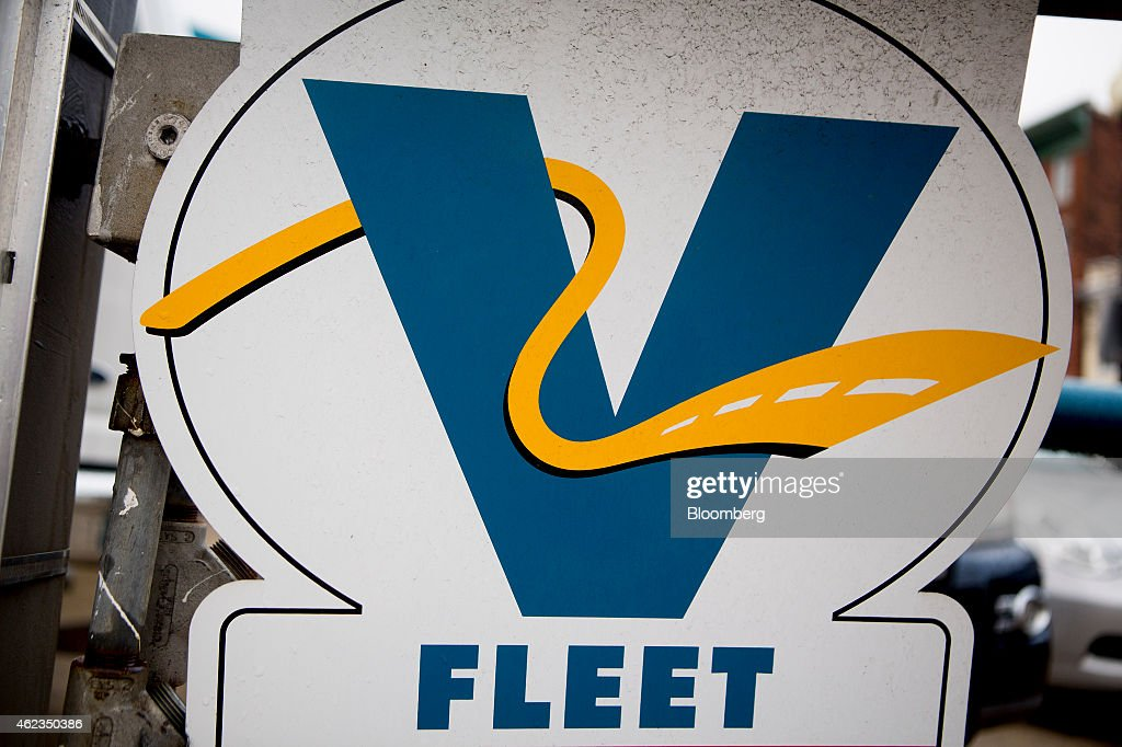 A Valero Energy Corp. Fleet credit card sign hangs at a gas station in Washington, D.C., U.S., on Monday, Jan. 26, 2015. Valero Energy Corp. is expected to report fourth-quarter earnings figures on Jan. 29. Photographer: Andrew Harrer/Bloomberg via Getty Images