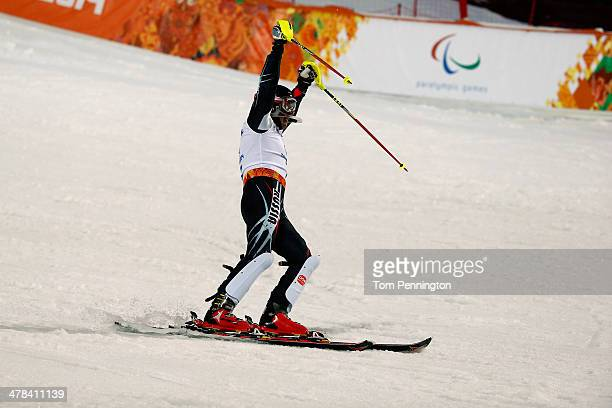 Valerri Redkozubov of Russia reacts at the finish line in the Men's Slalom 2nd Run Visually Impaired during day six of Sochi 2014 Paralympic Winter...