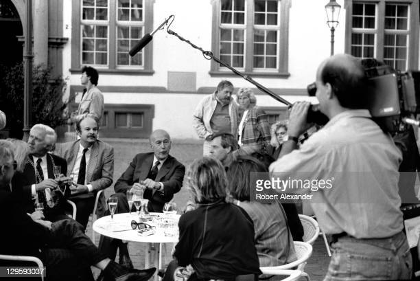 Valery Giscard d'Estaing , former president of France, talks informally with city leaders and residents of Koblenz, Germany, during a visit to the...