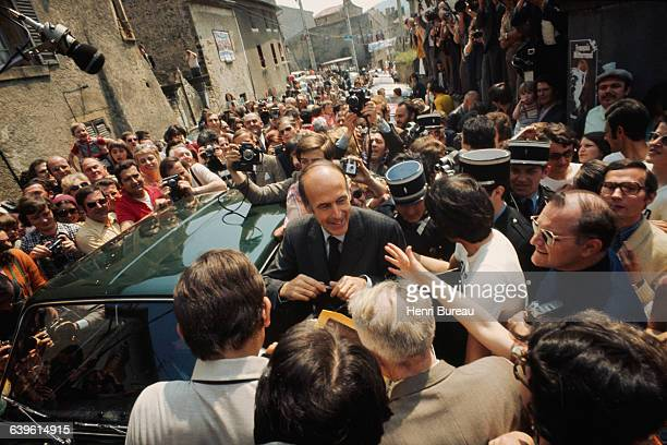 Valery Giscard d'Estaing heads to the polls to vote at the town hall of Chamalieres of which he is deputy mayor Wellwishers some wearing tshirts...