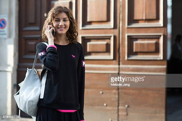 Valery Kaufman exits the Prada show in a VS Pink top poses on June 21 2015 in Milan Italy