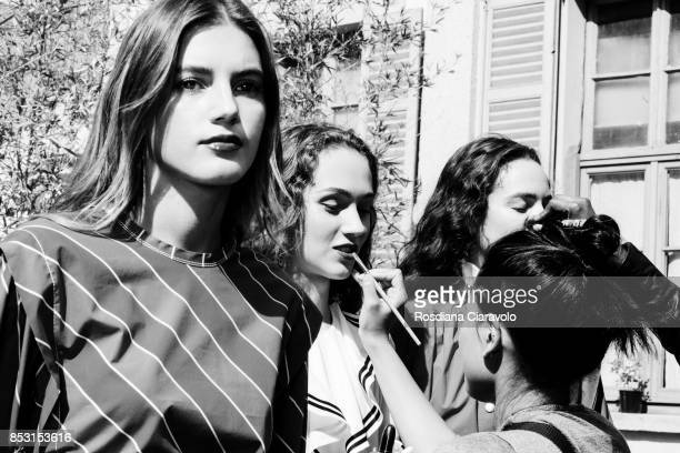 Valery Kaufman Michelle Gutknecht and Emm Arruda are seen backstage ahead of the Philosophy By Lorenzo Serafini show during Milan Fashion Week...