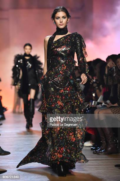 Valery Kaufman walks the runway during the Elie Saab show as part of the Paris Fashion Week Womenswear Fall/Winter 2018/2019 on March 3, 2018 in...