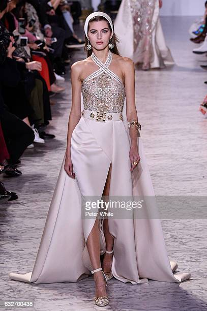 Valery Kaufman walks the runway during the Elie Saab Spring Summer 2017 show as part of Paris Fashion Week on January 25 2017 in Paris France
