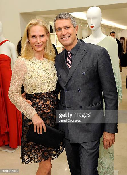 Valesca Guerrand Hermes and Vice President of Worldwide Public Relations Carlos Souza pose for a photo during the 100 Unforgettable Dresses book...