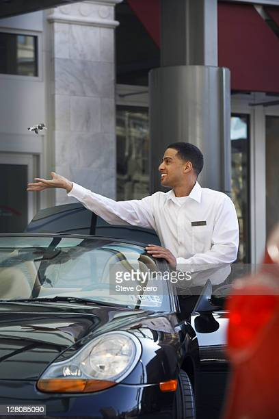 Valet attendant catching keys