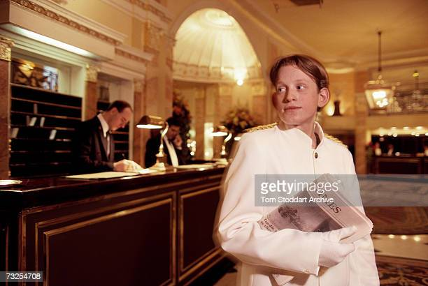 A valet delivering The Times newspaper to a guest at the Dorchester Hotel on Park Lane London April 1991