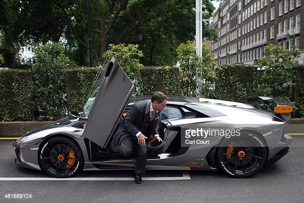 A valet exits after parking a Kuwaitiregistered Lamborghini Aventador LP7604 Oakley Design AlRashed Carbon Edition on July 23 2015 in London England...