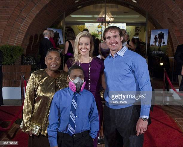 """Valetta Roshell and Micah Roshell arrive with New Orleans Saints NFL Quarterback Drew Brees and his wife Brittany Brees attend """"The Blind Side""""..."""