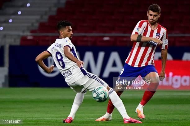 Valladolid's Brazilian midfielder Matheus Fernandes challenges Atletico Madrid's Spanish forward Alvaro Morata during the Spanish League football...