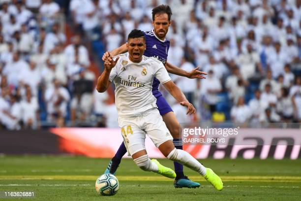 Valladolid's Spanish midfielder Michel challenges Real Madrid's Brazilian midfielder Casemiro during the Spanish League football match between Real...