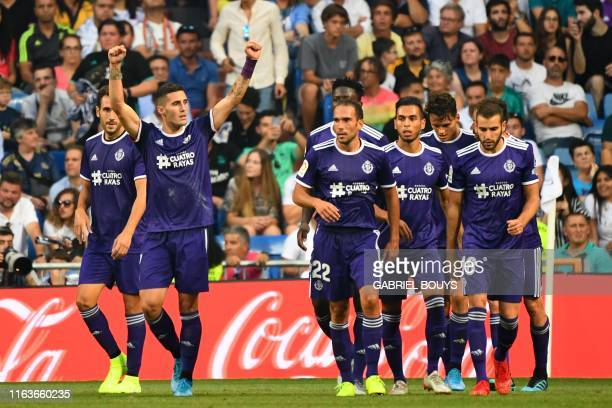 Valladolid's Spanish midfielder Sergio Guardiola celebrates after scoring during the Spanish League football match between Real Madrid and Real...