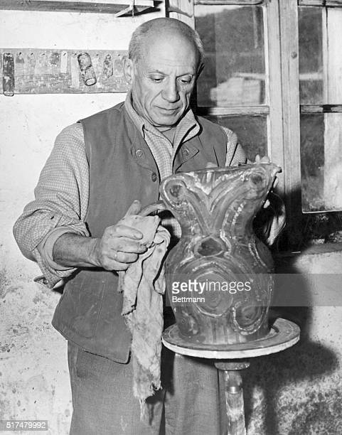 Pablo Picasso world famous artist painting an urn in the pottery workshop of Madame Ramie here on the French Riviera in March 1948